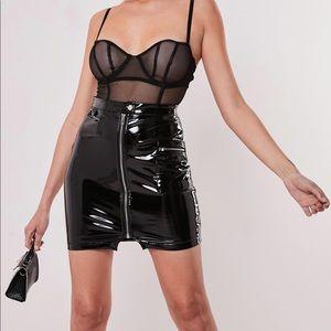 Black vinyl utility mini skirt